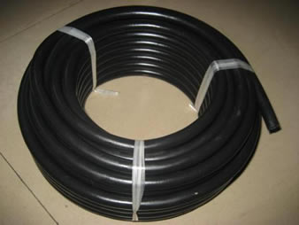 A roll black surface fuel oil hose fastened with plastic rope
