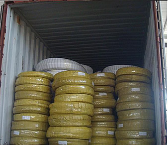 Many rolls plastic film packing high pressure steel wire spiral hose on container
