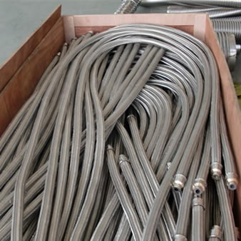 A lot of metal hoses in carton box
