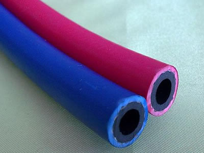 A twin welding hose with red and blue color