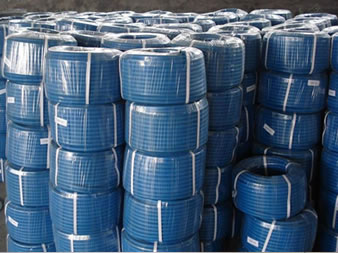 A lot of rolls of blue welding hose with plastic rope inside and PVC film outside packing in stock