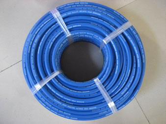 A roll blue welding hose with plastic rope on floor
